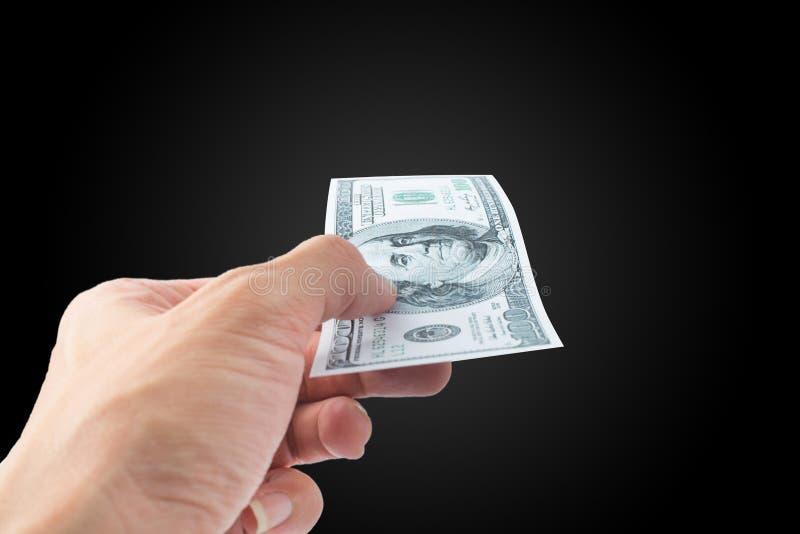 Entregue a cédula do dinheiro do pagamento, dólar de Estados Unidos USD imagem de stock royalty free