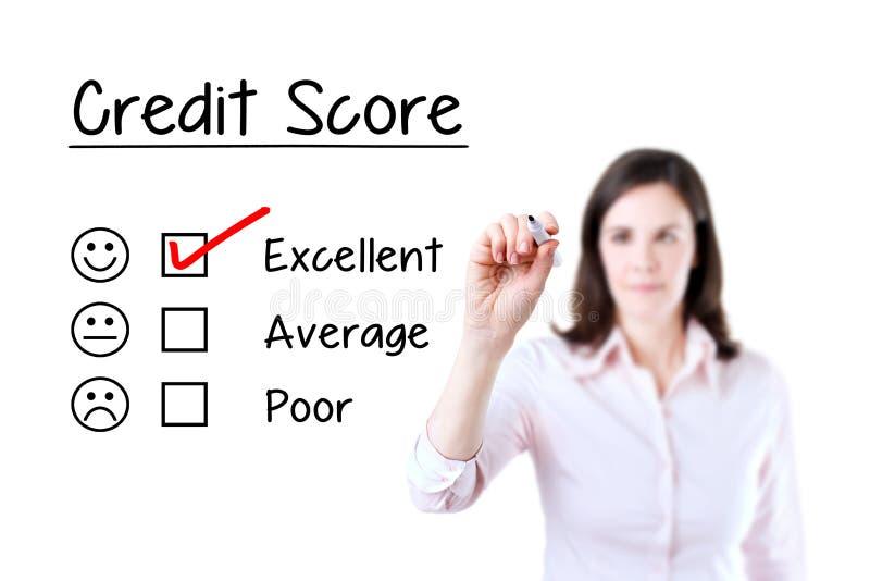 Entregue a colocação identificar de verificação por meio do marcador vermelho sobre o formulário de avaliação excelente da pontua fotos de stock royalty free