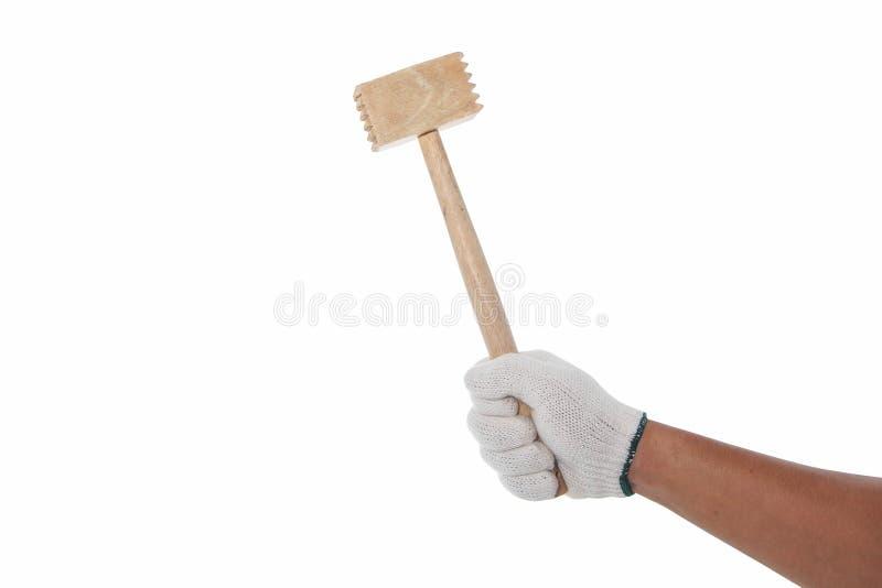 Entregue com a luva de trabalho que guarda o martelo de madeira imagens de stock royalty free