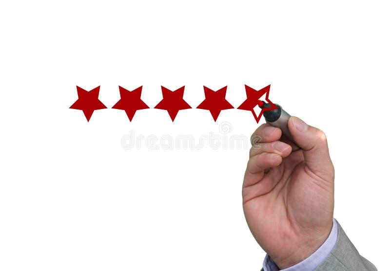 Entregue completar a quinta estrela da avaliação de desempenho fotografia de stock royalty free