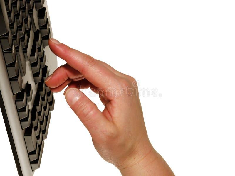 Entregue el teclado foto de archivo