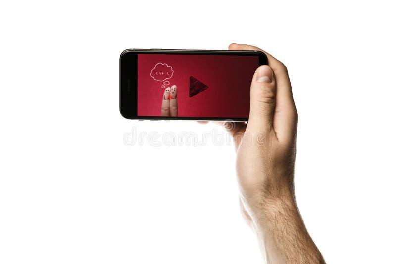 Entregue guardar o smartphone, tela vazia no fundo branco imagem de stock royalty free