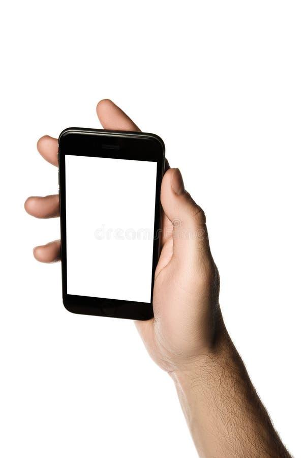 Entregue guardar o smartphone, tela vazia no fundo branco foto de stock royalty free