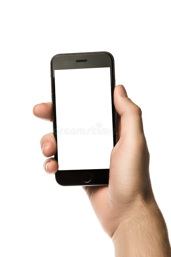 Entregue guardar o smartphone, tela vazia no fundo branco fotografia de stock royalty free