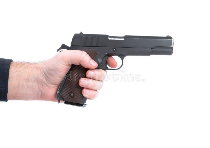 Entregue manter o revólver da pistola isolado no fundo branco fotografia de stock