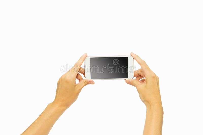 Entregue manter o telefone esperto isolado no fundo branco fotos de stock