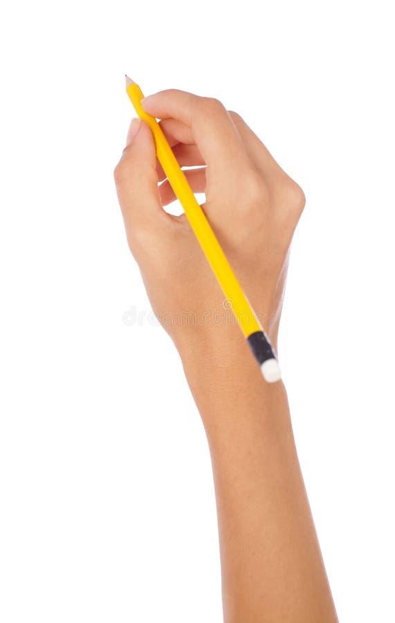 Entregue prender um lápis imagens de stock royalty free