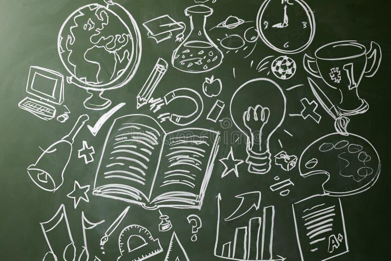 Entregue símbolos tirados de assuntos de escola em um quadro imagem de stock royalty free