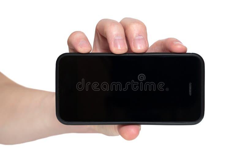 Entregue a terra arrendada o telefone esperto m?vel com tela em branco Isolado no branco foto de stock royalty free