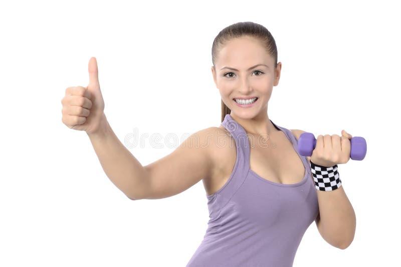 Entrenamiento del peso de la mujer de la pesa de gimnasia en gimnasio fotografía de archivo libre de regalías