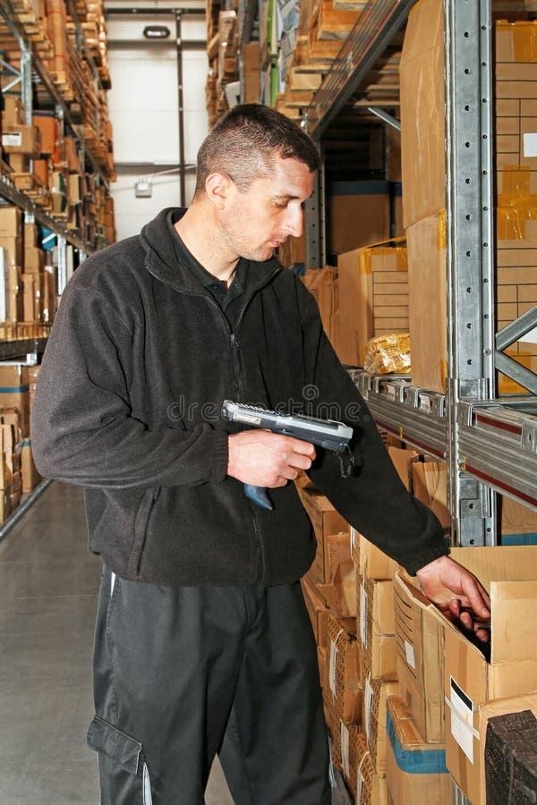 Entreposez l'ouvrier image stock