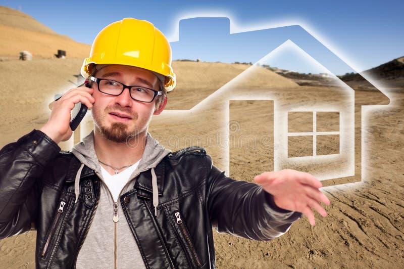 Entrepreneur à un sort de chantier et de saleté de construction photographie stock