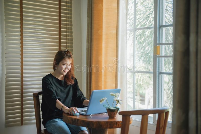 Entrepreneur asian woman working with a laptop at home. stock image