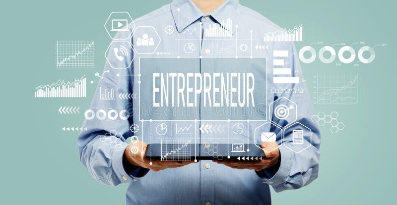 Entrepreneur concept with man holding a tablet stock photos
