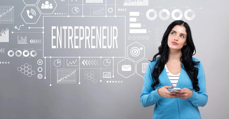 Entrepreneur concept with woman holding a smartphone stock images