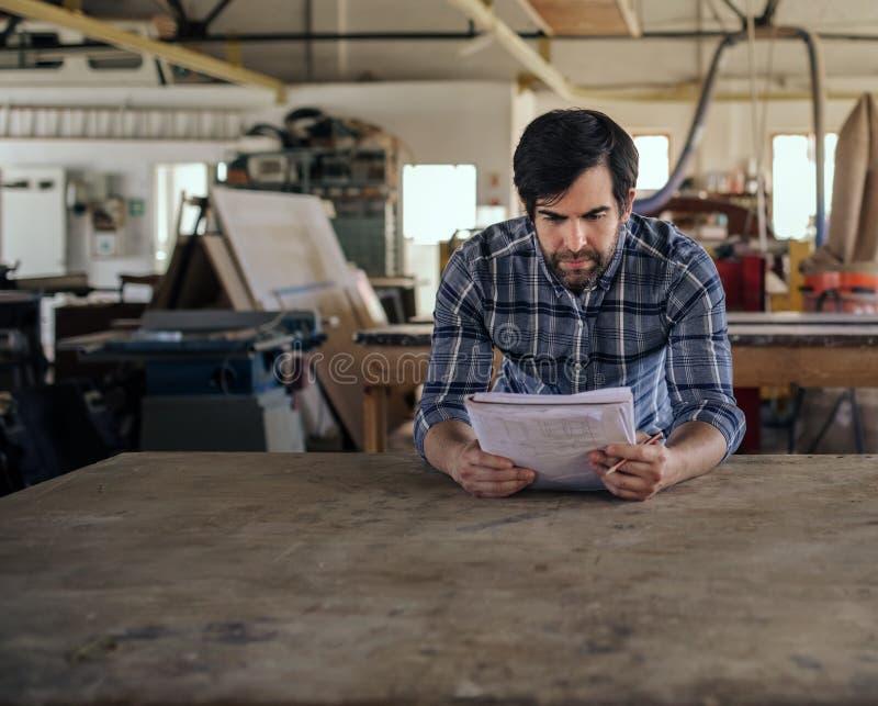 Entrepreneur creating a new design in his furniture workshop stock images
