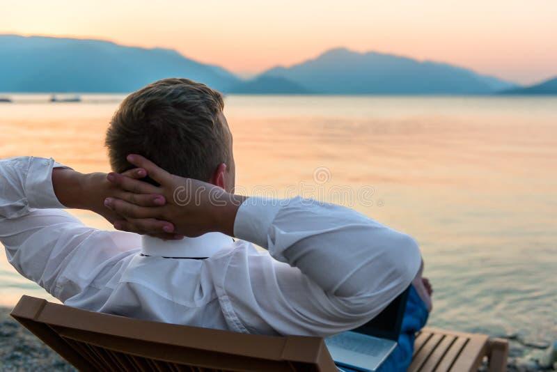 Entrepreneur enjoys staying on beach. Entrepreneur enjoys staying on the beach stock photography