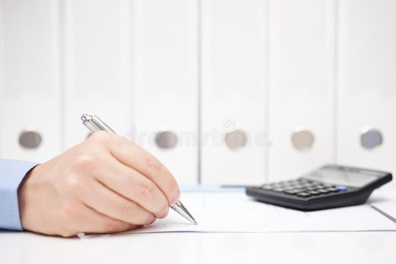 Entrepreneur filling the tax form stock photos