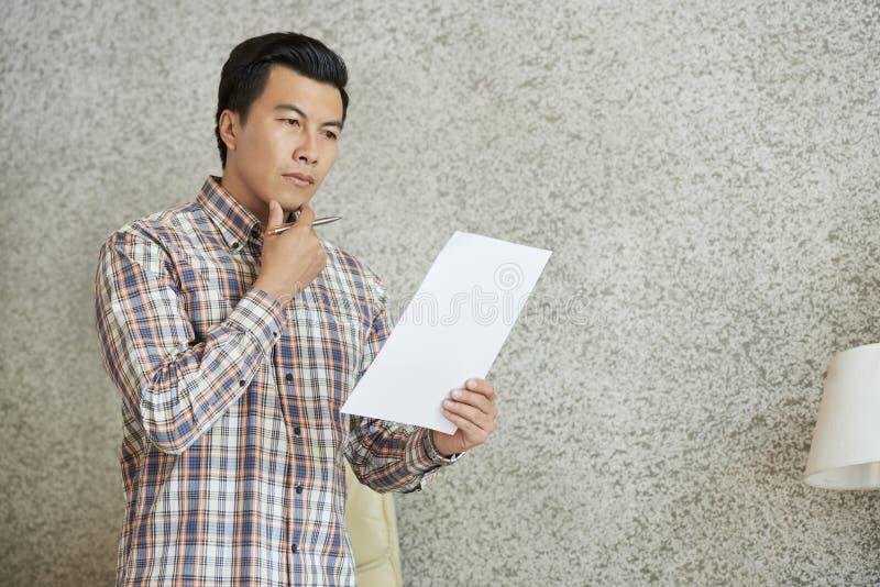 Entrepreneur reading document stock image