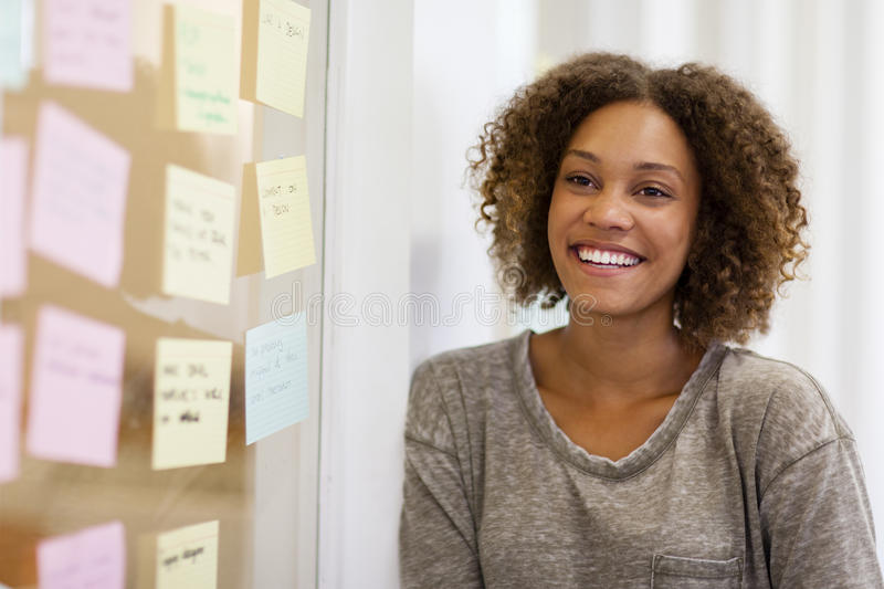 Entrepreneur smiling in front of her task cards stock photos