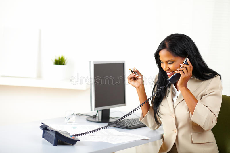 Download Entrepreneur Talking On Phone At Work Stock Image - Image: 24582549