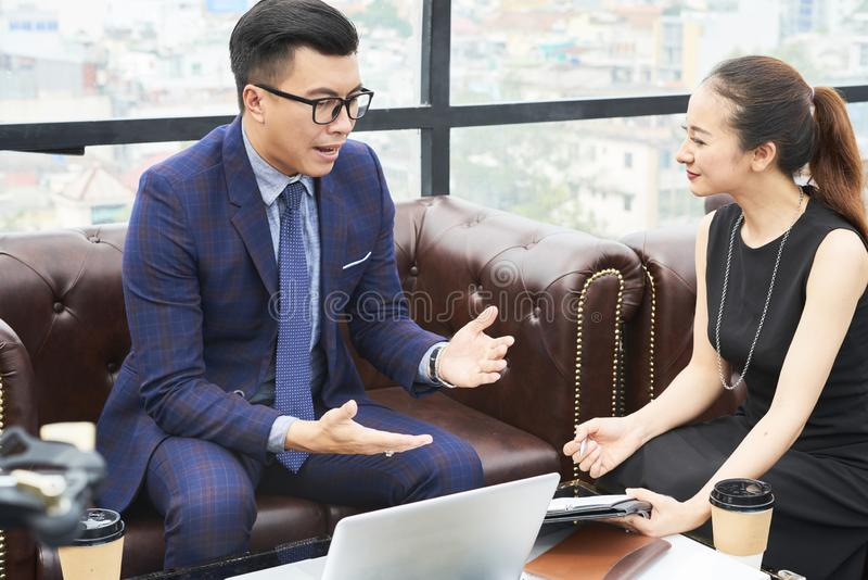 Entrepreneur talking to business partner stock image