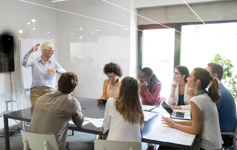Entrepreneurs and business people conference in meeting room stock photography