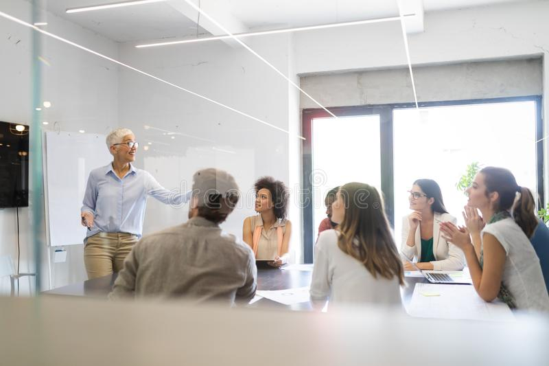Entrepreneurs and business people conference in meeting room royalty free stock images