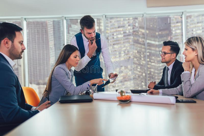 Entrepreneurs and business people conference in meeting room. Selective focus stock image