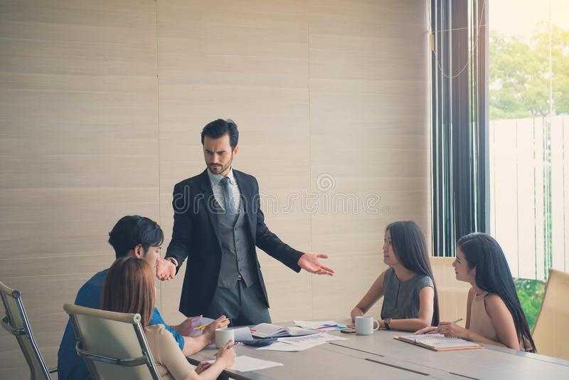 Entrepreneurs and Business People discussing together in conference room during meeting at office, teamwork concept stock photo