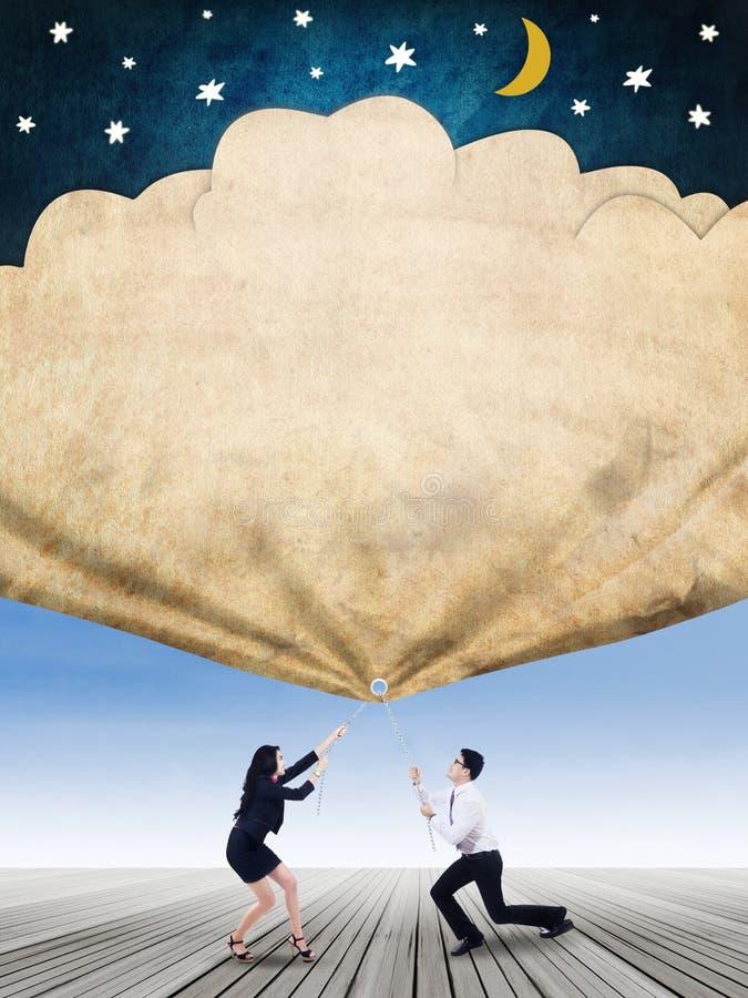 Entrepreneurs pull a flag of their hopes vector illustration