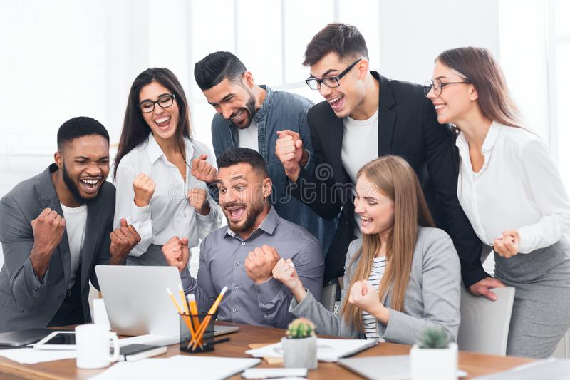 Entrepreneurs team celebrating victory in office royalty free stock image