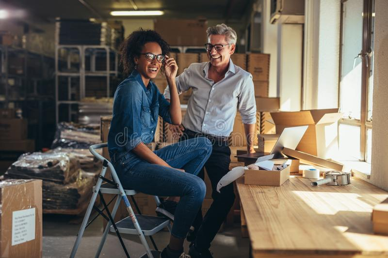 Entreprenuers at online store warehouse royalty free stock images