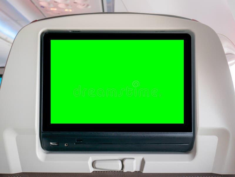 Entretenimiento de aviones con la pantalla verde, pantalla del Seatback con la pantalla verde en aeroplano imagen de archivo libre de regalías
