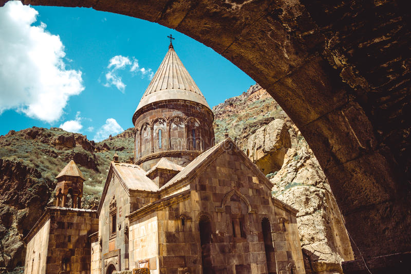 Entry through arch to cave monastery Geghard, Armenia. Armenian architecture. Pilgrimage place. Religion background. Travel concep. T. Church Astvatsatsin royalty free stock photography