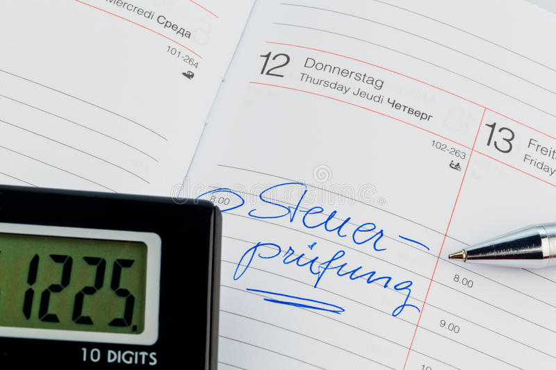 Entry in the calendar: tax audit. A date is entered in a calendar: tax audit royalty free stock images