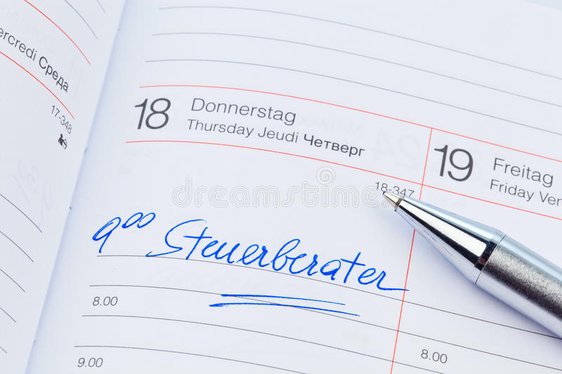 Entry in the calendar: tax consultant. An appointment is entered in a calendar: tax consultant royalty free stock photos