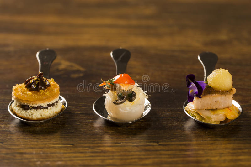 Entry, entree and dessert of finger food in a spoon. Taste gastronomy finger food royalty free stock photo