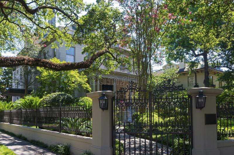 Entry Gate Garden and Home in Historic New Orleans. Entry gate and landscaped yard to home in historic garden district of new orleans louisiana stock photos