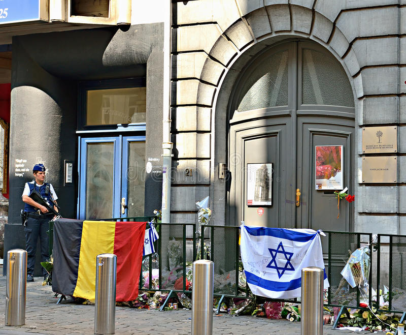 Entry in Jewish Museum of Belgium. BRUSSELS, BELGIUM-JUNE 2, 2014: Candles, flags and flowers on front of the entry in Jewish Museum of Belgium for condolences stock image