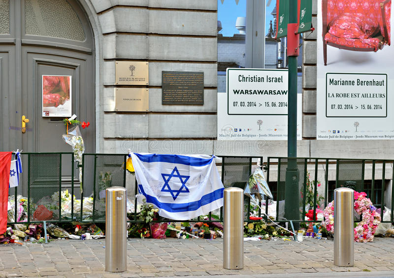 Entry in Jewish Museum of Belgium. BRUSSELS, BELGIUM-JUNE 2, 2014: Candles, flags and flowers on front of the entry in Jewish Museum of Belgium for condolences royalty free stock image