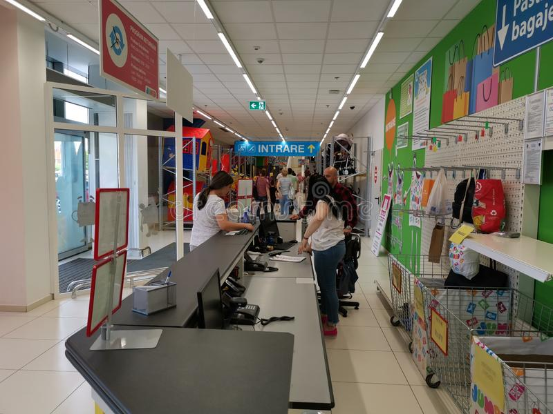 Entry at Jumbo store, Romania - people at the reception stock photos