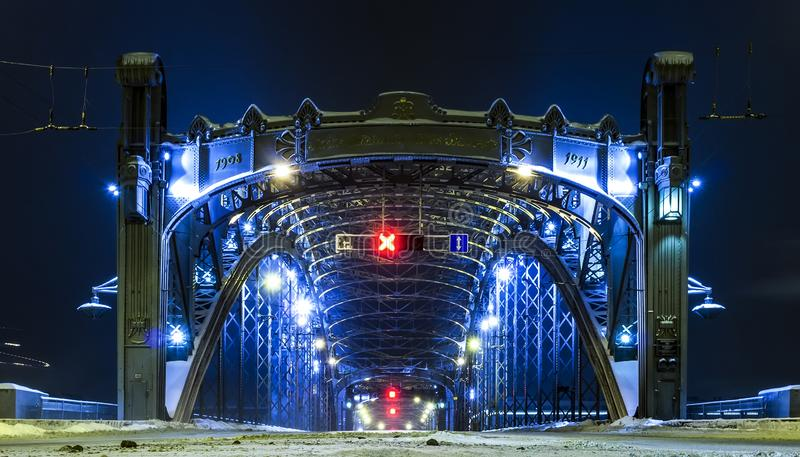 Entry to Bolsheokhtinsky bridge. Winter Saint Petersburg, Russia. Evening with night illumination. Red warning sign no entrance. Divorced bridges. Front view royalty free stock photography