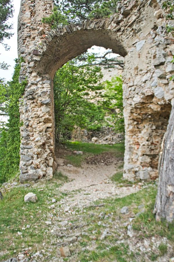 Entry to an old castle ruin in the forest. Entry to an old castle ruin slovakia countryside mansion bankruptcy exploration luxury desolate forest ghost town road stock photos