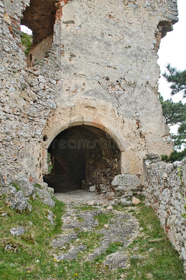 Entry to an old castle ruin in the woods. Entry to an old castle ruin hospital slovakia countryside mansion bankruptcy exploration luxury desolate forest ghost royalty free stock photography