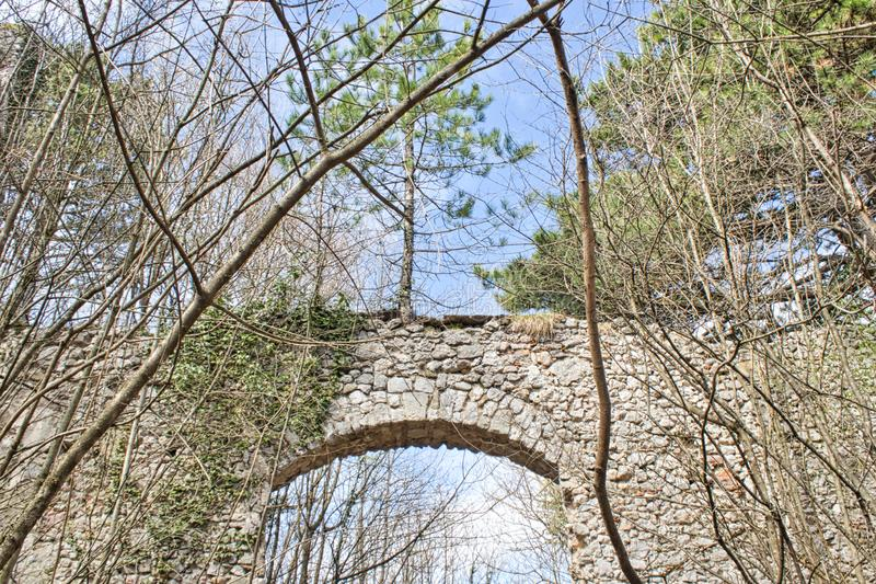 Entry to an old castle ruin in the woods. Springtime abandoned autumn bankrupt bankruptcy building burned country countryside damaged desolate empty europe stock photo