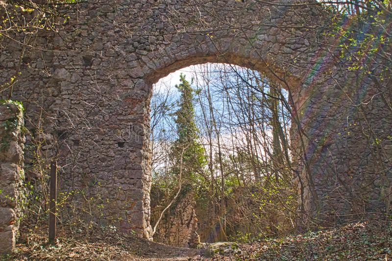 Entry to an old castle ruin in the woods. Springtime abandoned autumn bankrupt bankruptcy building burned country countryside damaged desolate empty europe royalty free stock image