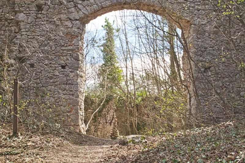Entry to an old castle ruin in the woods. Springtime abandoned autumn bankrupt bankruptcy building burned country countryside damaged desolate empty europe stock image
