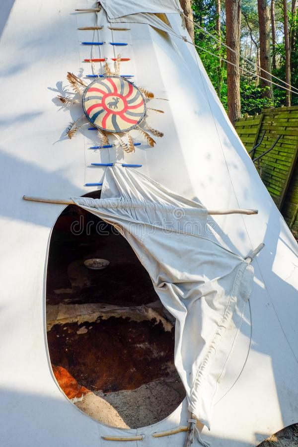 Entry of a wigwam royalty free stock photography