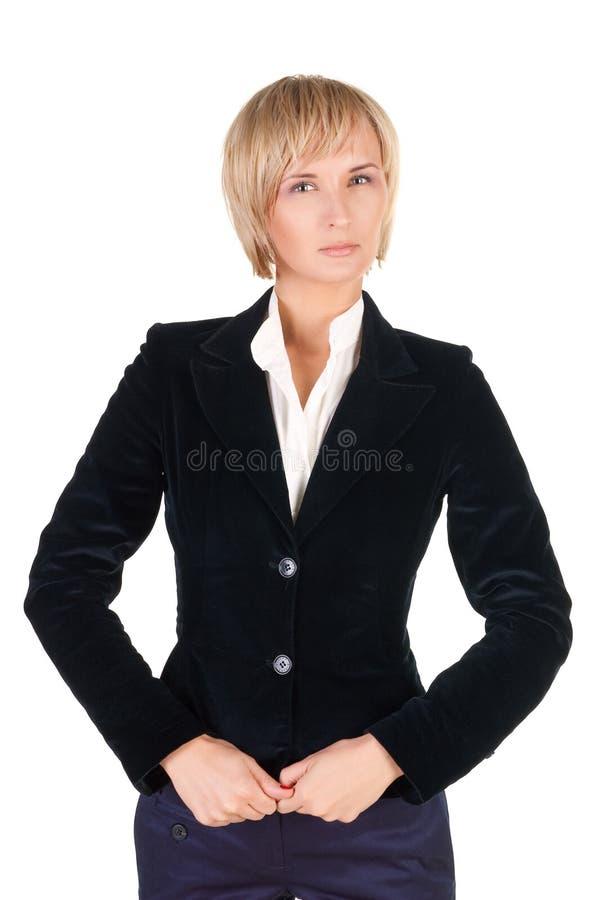 Entschlossene blonde Frau in der Klage. lizenzfreies stockfoto